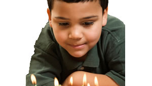 Capital One Wish for Others Launches - Boy Blowing Out Candles